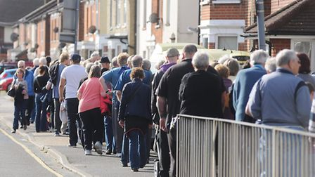 Queue outside Derby Road Surgery, Ipswich, to receive their flu jab on Saturday