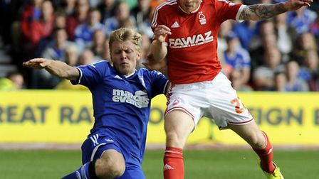 Jonathan Parr clears under pressure from Forest's Chris Burke