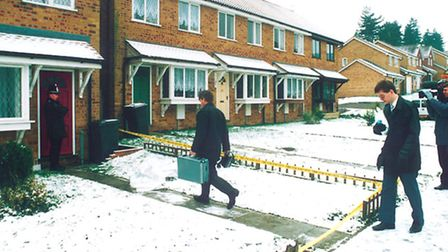 Police approaching the house in which Karen Hales was murdered