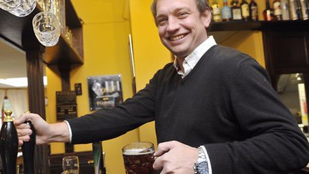 Greyhound landlord Dan Lightfoot celebrates it being named Adnams Pub of the Year.