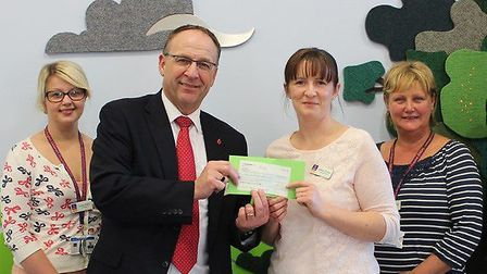 The presentation of the cheque for £10,000 to East Anglia's Children's Hospices by the East of Engla