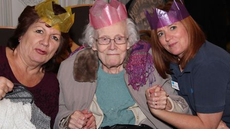 Monmouth Court staff Irene Umbenhen (left) and Sally Elliss with resident Marlorie Parish at the te