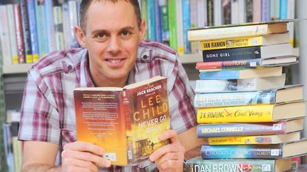 Top 10 most popular books in Suffolk's Libraries. Pictured is James Powell.