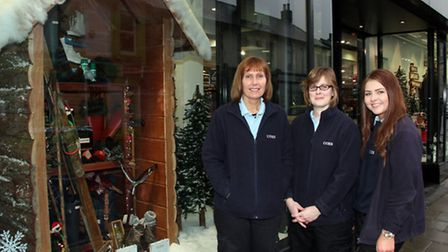 Annette Keeble (L to R) Sonja Talbot and Sarah Taylor of Coes with part of the christmas window disp