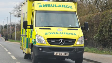 A seriously injured biker was taken to hospital by ambulance following a collision in Ipswich