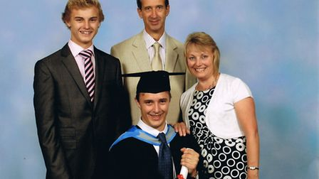 Rosalind and Tony Wheeler with Cameron (standing) at Alistair's graduation