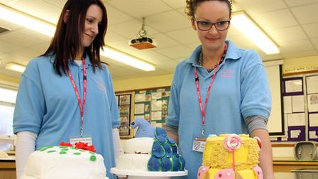 Kerry Robinson (left) and Gemma Rattle judge the Great Kesgrave Bake Off. Photograph Simon Parker
