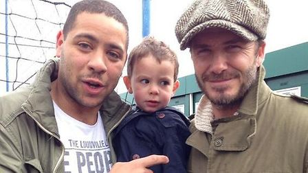 Luke Rutter and his son with David Beckham at Ipswich Town's Playford Road training ground in May