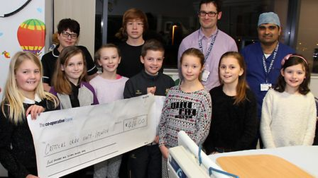 The Critical Care team at Ipswich Hospital recieve a cheque from Sophie Burgess and her friends who
