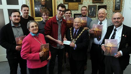 UCS Students present proceeds of their magazine on Suffolk and the War to Ipswich Mayor Bill Quinton