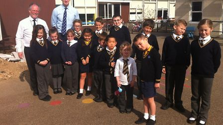 Headteacher Stephen Barker with Dr Dan Poulter and members of the school council at St Pancras Prima