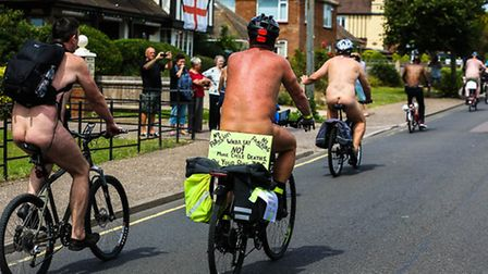 Onlookers watch the naked cyclists on their ride. World Naked Bike Ride at Clacton, on July 19 2014.