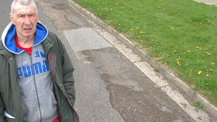 Michael Case next to the potholes in Plymouth Road, Felixstowe that he wants to see fixed.