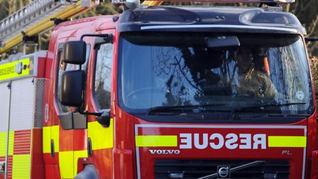 Car fire spreads to neighbouring vehicles and outbuilding