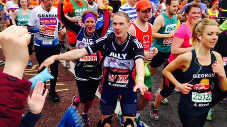 Nichola Whymark and her brother, Ali Wright at the 6.5 mile mark of the London Marathon.