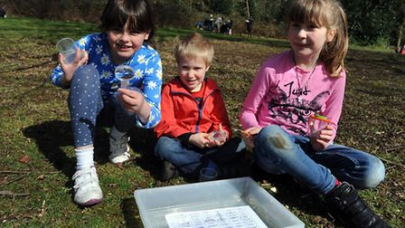 Easter holiday fun in Holywells Park in Ipswich. Children take part in a bug hunt. L-R: Chloe Green