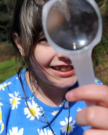 Easter holiday fun in Holywells Park in Ipswich. Children take part in a bug hunt. Chloe Green (8).