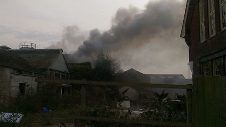 Smoke billows from the blaze close to Cliff Quay in Ipswich Photo: Mike Keen