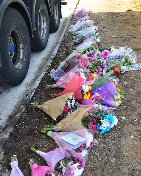 Floral tributes in the layby at Bucklesham on the A14, scene of the fatal accident on Wednesday nigh