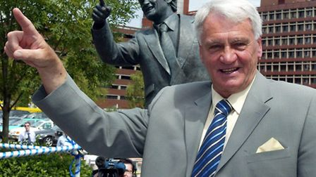 Sir Bobby Robson with a statue of himself as Ipswich Town manager. Photo: Andrew Parsons