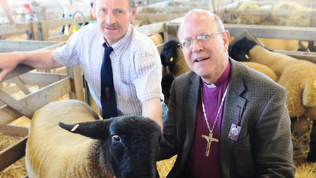 The new bishop of St Edmundsbury and Ipswich Rt Rev Martin Seeley meets Merrick pinny with champion