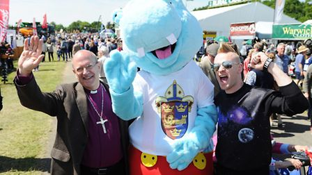 The new bishop of St Edmundsbury and Ipswich Rt Rev Martin Seeley with Harry the hippo and Chip Kend