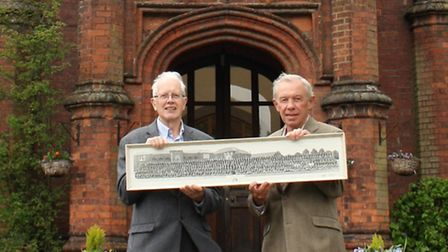 Michael Warner (left) and John Rendle (right) with an Ipswich School photo showing pupils who left i