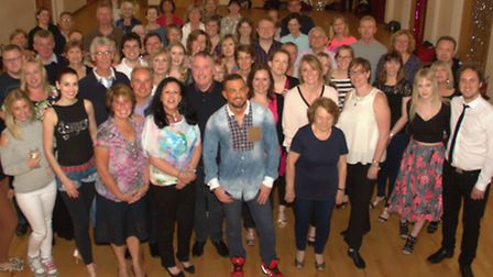 Robin Windsor, of Stricly Come Dancing, poses with ballroom dancing students.