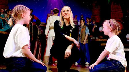 Amelia Lily as the Narrator in Joseph and The Amazing Technicolor Dreamcoat. Photo: Shaun Flannery