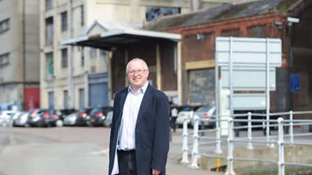 David Ellesmere in front of the buildings that the council have just purchased on the Ipswich waterf