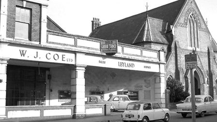 Crown Street around 1967 featuring W J CoeÕs garage and the Congregational Church at the corner of H