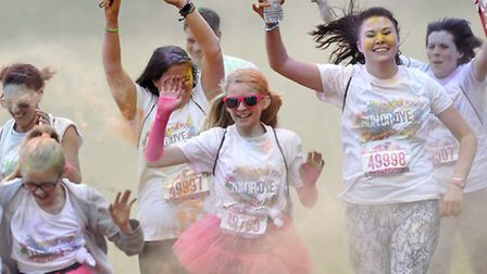 Runners get doused in coloured powder at the Run or Dye 5K in Chantry Park on Saturday, 25 July.