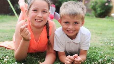 Nine-year-old Megan-Lucy Neville, with six-year-old brother Jacob-James, who has found a five-leaf c