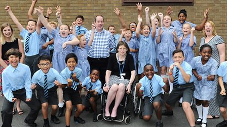 Pupils and staff at St Matthew's Primary School in Ipswich celebrate a 'good' Ofsted report.
