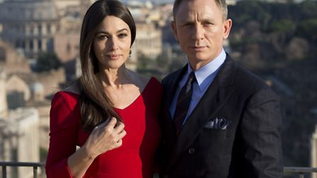 Actors Monica Bellucci, left, and Daniel Craig pose during a photo call for the latest James Bond mo