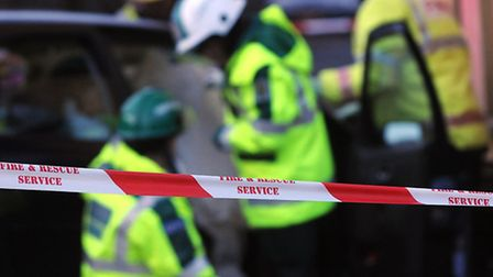 Emergency services attend the scene of a crash. Library image.