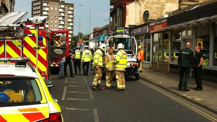 The scene in Norwich Road, Ipswich, after a vehicle hit a bridal store and a cafe
