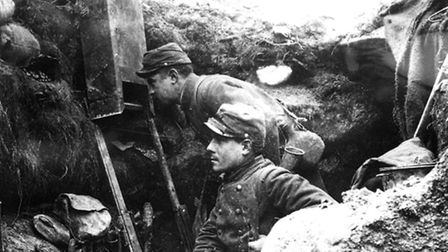 Watching and waiting. A French soldier uses a periscope to check on the enemy, who wasn't far away