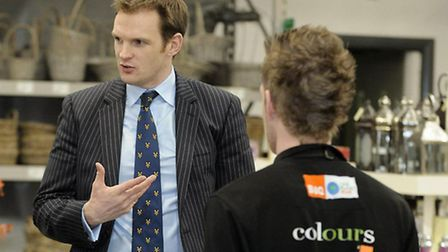 Dan Poulter with employees at B&Q