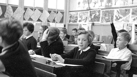 Carol MacPherson and Malcolm Fenn are in the centre of this picture at St Matthews School, Ipswich.