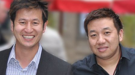 Patrick Cheung, right, with brother, Vincent.