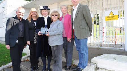 Judith shallow high sherif of Suffolk receives an award from Janet adams, Joy mackie and Mark Ling f