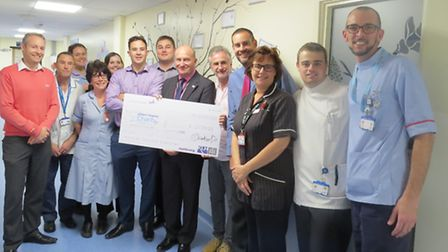 The KLH Architects team present Ipswich Hospital's Chief Executive, Nick Hulme, with a cheque for £2