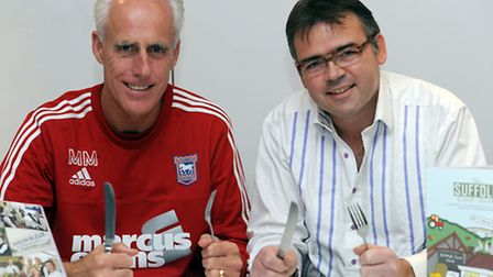 Mick McCarthy and Pascal Canevet, owner of Maison Bleue in Bury St Edmunds, at the Ipswich Town trai