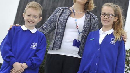 Halifax Primary Head teacher Anna Hennell James and her pupils Carly and Freddie celebrate their Goo