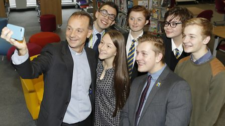 Revd Canon Dr Mike Harrison taking a selfie with students at Felixstow Academy at the time of his an