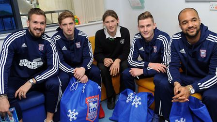 Ipswich Town players visit Ipswich Hospital to give out presents. L-R: Luke Chambers, Teddy Bishop,
