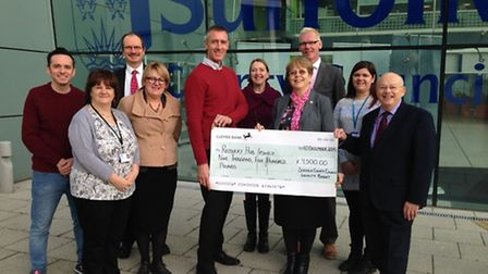 The Labour group outside Endeavour house with a cheque for The Oak.