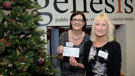Penny Arbuthnot, director at Genesis PR presents a £300 Christmas gift to Carole Thain of Suffolk Mi