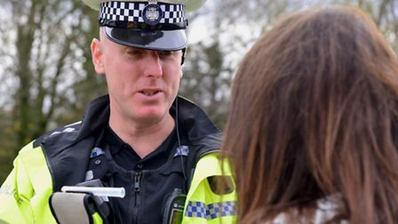 Inspector Julian Ditcham breathalyses a motorist while out on patrol